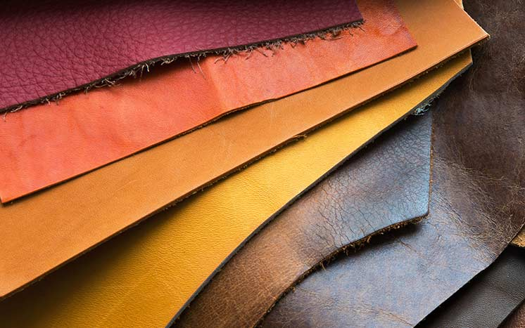 Leather restoration samples in our Leicestershire workshop